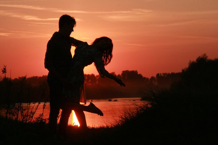 cute love couple at sunset image