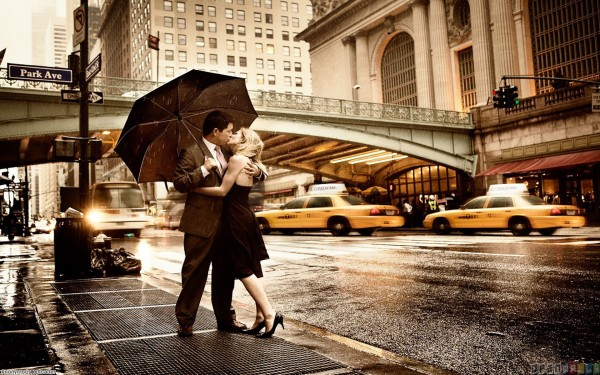 Couple engaged in love in rain wallpaper