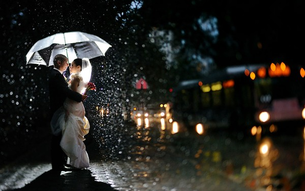 First hug of couple in rain after getting married