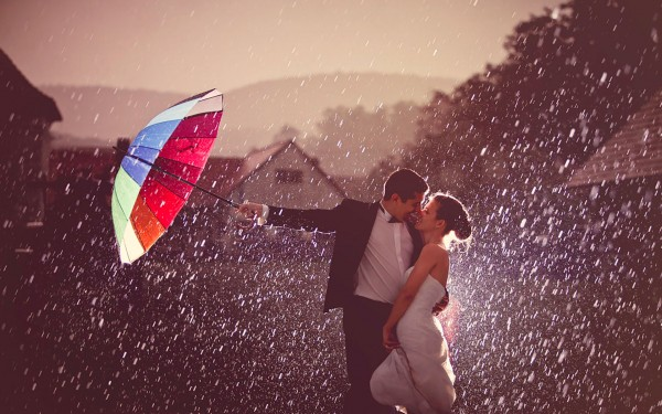 First kiss in rain after getting married