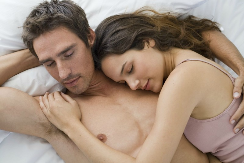 Happy couple sleeping in bed felling the heaven on earth