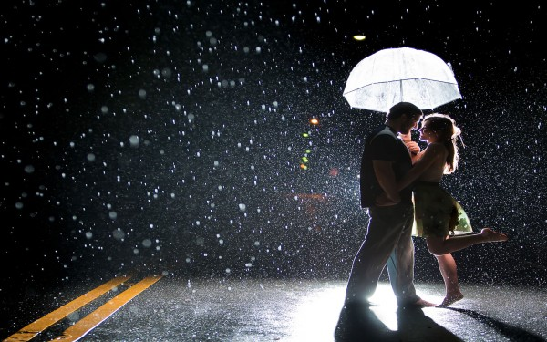 Joy of couple on a rainy street
