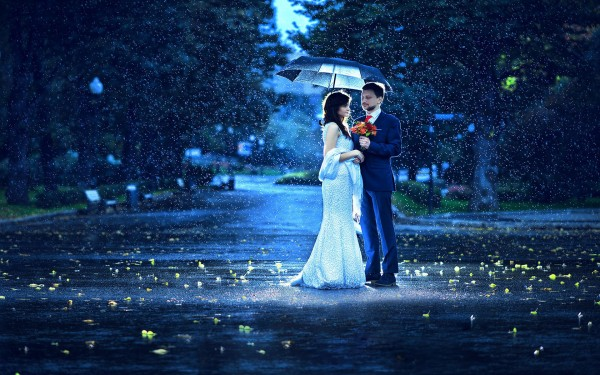 Sweet Couple giving flower in a rainy Morning