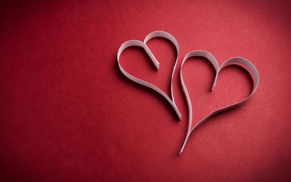 Love wallpapers of two paper hearts on red background